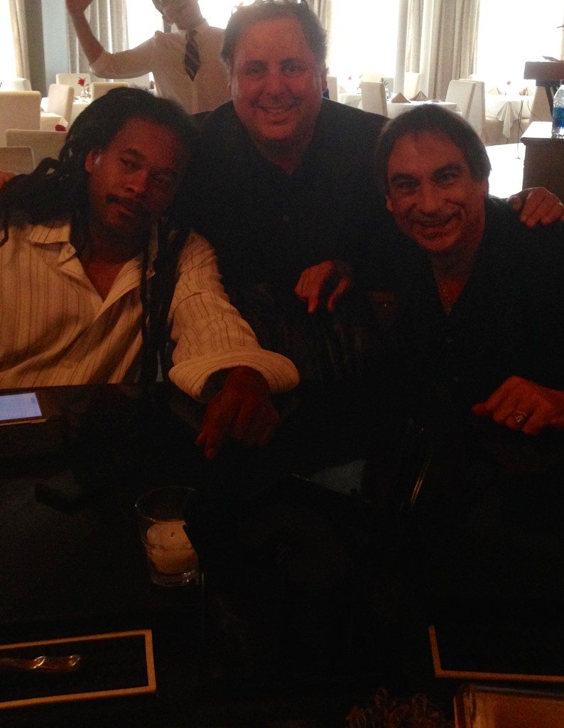 Quentin Baxter, Howard Paul and Tony Monaco being photo bombed by a waitress.