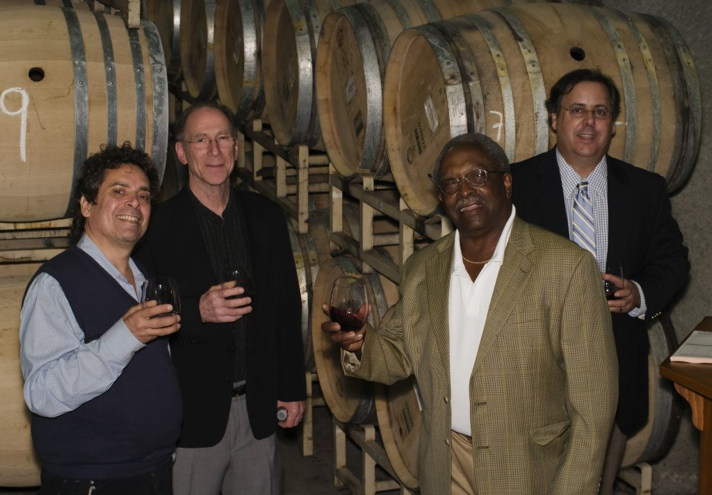Howard Alden, Bob Benedetto, Ben Tucker, and Howard Paul sampling from the wine barrels at Miner Family Winery. Mike Oria Photography